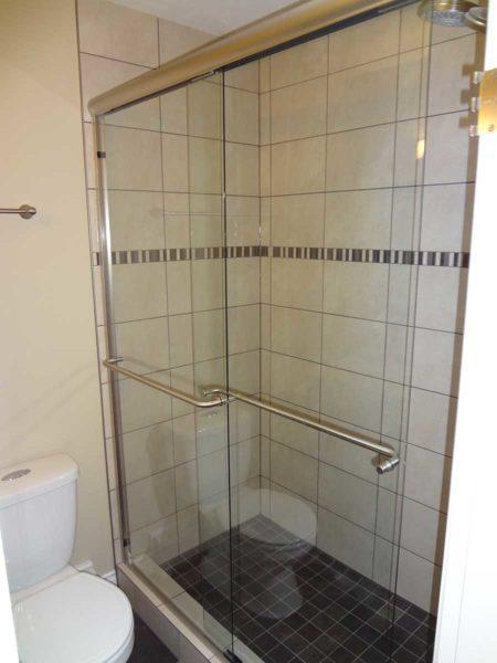 Framed sliding shower enclosure.